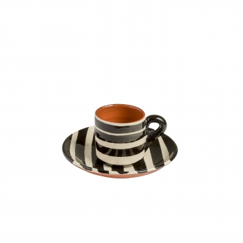 Striped black and white cup and saucer